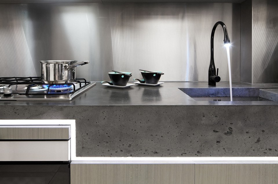 LED strip lights installed beneath polished concrete kitchen work surface add charisma to the kitchen.