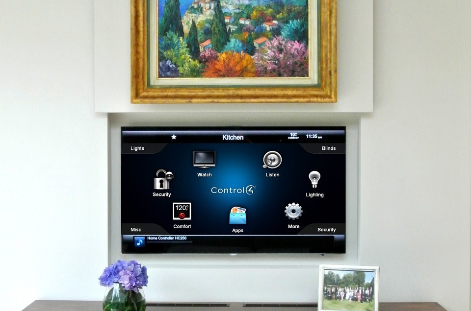This flat screen hides behind an oil painting when not in use.
