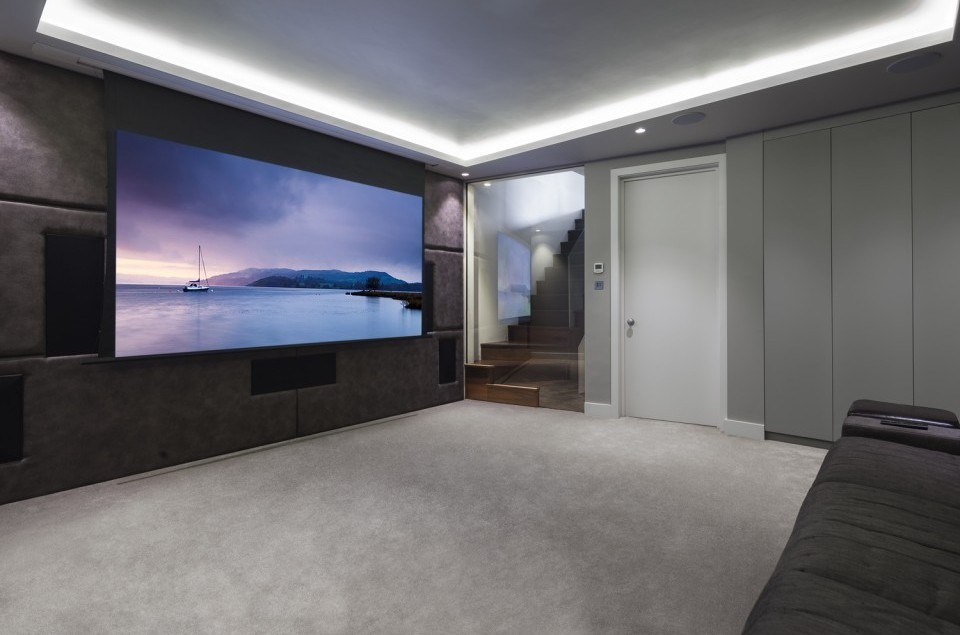 Cosy home cinema with JVC projector and Bowers and Wilkins surround sound system.