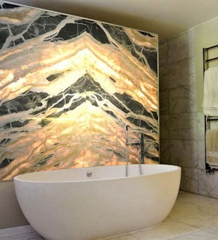 Lighting doesn't have to be functional. This gorgeous marble feature works as a divider for bath and shower, whilst presenting a relaxing glow to the room.