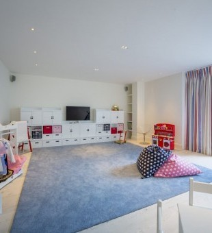 Snug area complete with a smart TV and Bowers and Wilkins on-wall speakers.