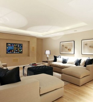 Featuring a Kaleidescape movie server and hidden projector, this living room epitomises multi-functioning living. A good solution if you don't have a dedicated space for a movie room.