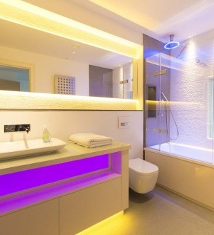 Who says bathrooms have to be boring? Lighting creates a look where space is at a minimum.