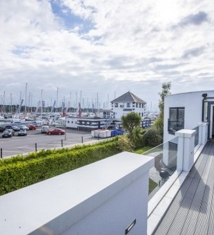 Impressive views of the marina from the terrace, featuring a Bowers and Wilkins waterproof speaker - ideal for the summer seasons and entertaining guests on the terrace.