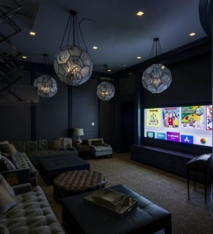 Inside the Cinema Room it includes Crestron Speakers, Integra DTR-60.6, Barco Projector, a screen research 115-inch screen and Crestron lighting control.