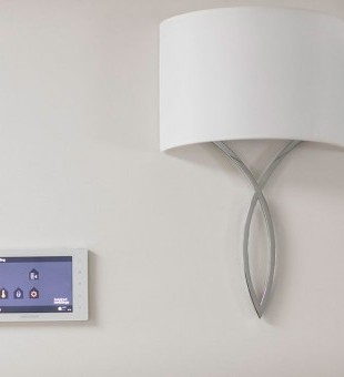 Crestron wall touch screen allows you to control your whole home at a touch of a button.