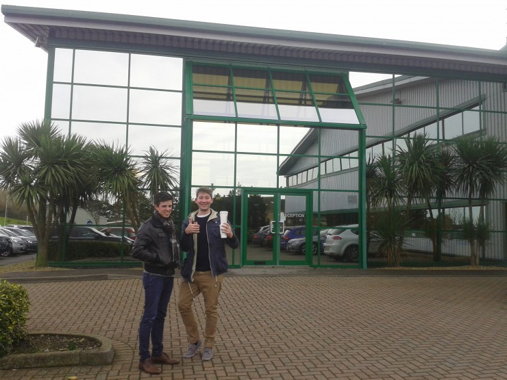 A caffeine fuelled Casey and Tom showing their enthusiasm, standing outside the world famous B&W Factory in Worthing